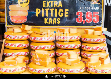 Close up of speciality Dutch cheese wheels on a market stall in Eindhoven, Netherlands - Stock Photo