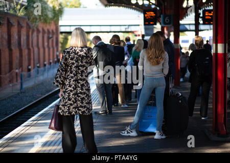 Passengers waiting for a delayed train at Marylebone Station in Central London - Stock Photo