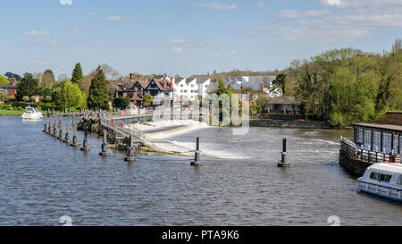 Marlow, England, UK - April 18, 2015: The River Thames flows over a weir at Marlow Lock in Buckinghamshire. - Stock Photo
