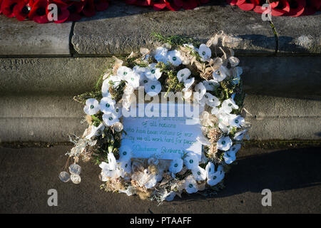 Remembrance Day white poppy wreath at a war memorial in Chichester, West Sussex, UK. - Stock Photo