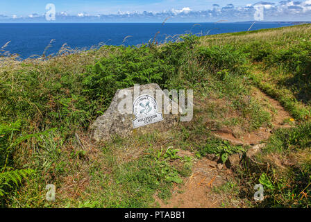 A National Trust Omega sign saying Hellesveor Cliff, near St. Ives, Cornwall, England, UK (photo taken from public footpath) - Stock Photo