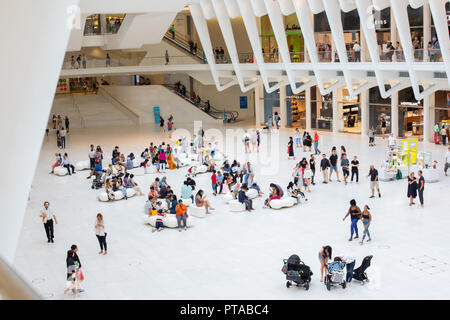 NEW YORK - August 2018: Inside Oculus shopping mall Westfield during busy day, World Trade Center Transportation Hub in New York, USA - Stock Photo