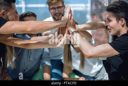 creative business team showing their unity - Stock Photo