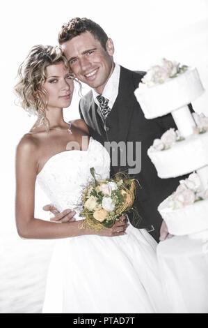 pridal couple outside, with weddingcake (model-released) - Stock Photo