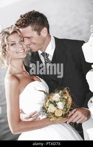 bridal couple outside, with weddingcake (model-released) - Stock Photo