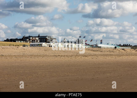 Katwijk, Netherlands - April 23, 2017:  Row white beach houses at the Dutch coast in Katwijk, Netherlands - Stock Photo