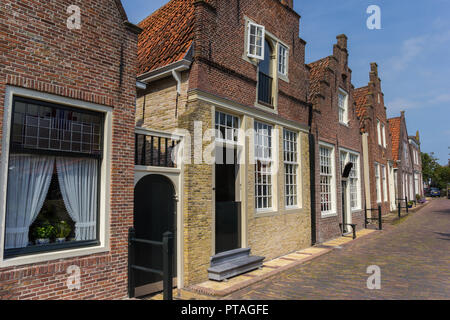 Traditional dutch houses in a street in Monnickendam, Holland - Stock Photo