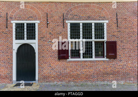 Door and window of an old house in Monnickendam, Holland - Stock Photo