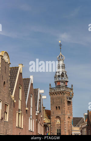 Row of houses and hisotric tower in the center of Monnickendam, Holland - Stock Photo