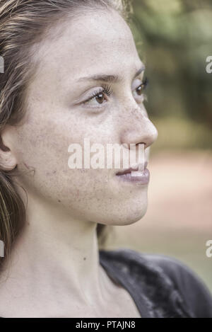 Yound woman in her garden, near Vienna, Austria (model-released) - Stock Photo