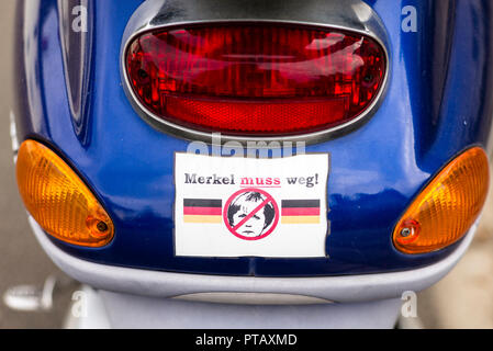 Sticker on a scooter calling for demission of German chancellor Angela Merkel. After 13 years in the office, the politician is widely criticised in he - Stock Photo