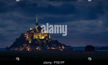 After sunset at Le Mont Saint Michelle (France) in summer, blue hour - Stock Photo
