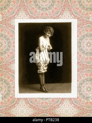 vintage photo of a woman in period dress - Stock Photo