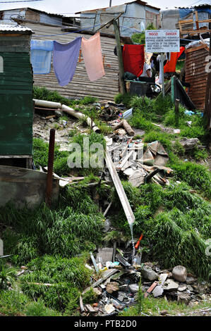 Drainage system in the township village of Imizamo Yethu a shanty town in Hout Bay, Cape Town, South Africa 2008 - Stock Photo
