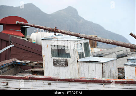 A scrapped old boat is left discarded with a funny message that reads I'm old please dont climb on me, in Hout Bay, Cape Town, South Africa - Stock Photo