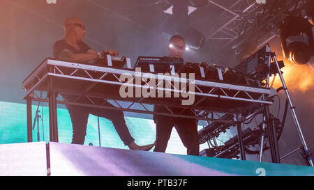 Phil and Paul Hartnoll of EDM duo, Orbital, performing at George Square, Glasgow, Scotland, on 10th August, 2018, during Festival 2018 - Stock Photo