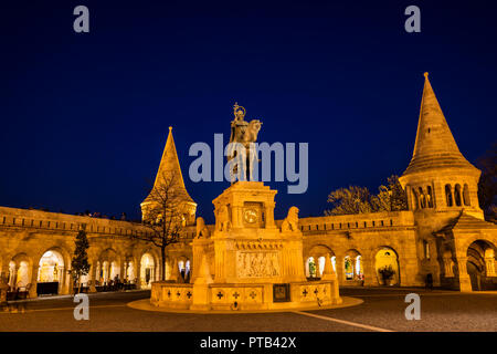 Budapest Fishermen's Bastion with statue of St Stephen sculpture at night - Stock Photo