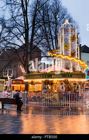 York, UK – 12 Dec 2016:Cockerels Merry-Go-Round at dusk on 12 Dec at Stonegate, York - Stock Photo