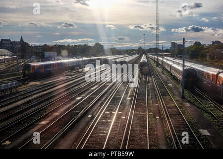 South Western Railways trains at Clapham Junction Railway Station in London UK - Stock Photo