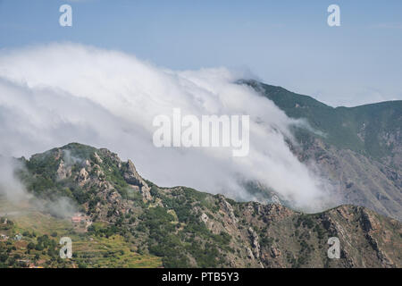 clouds passing mountains - forest mountain landscape - Stock Photo