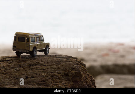 Off-road vehicle goes on the mountain way during the rainy season - Stock Photo