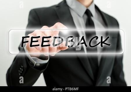Closeup of businessman pressing Feedback button on virtual screen. - Stock Photo