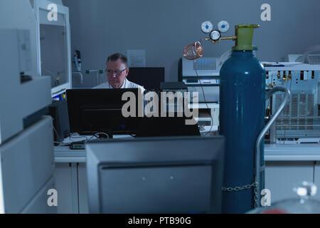 Male scientist working in laboratory - Stock Photo