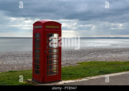 A lonely Telephone booth on the promenade of Budleigh Salterton on the  south west coast of Britain. 20 March 2018 - Stock Photo
