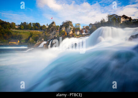 The Rhine Falls (German: Rheinfall) is the largest waterfall in Switzerland and Europe. The falls are located on the High Rhine on the border between  - Stock Photo