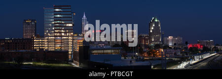 Downtown Raleigh, NC panoramic skyline at dusk with PNC Plaza reflecting the days last light (editorial) - Stock Photo