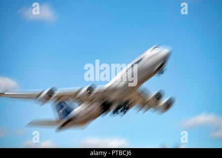 Boeing 747 of Lufthansa (D-ABYA) with new logo and motion blur [M] after takeoff from Frankfurt airport - Stock Photo