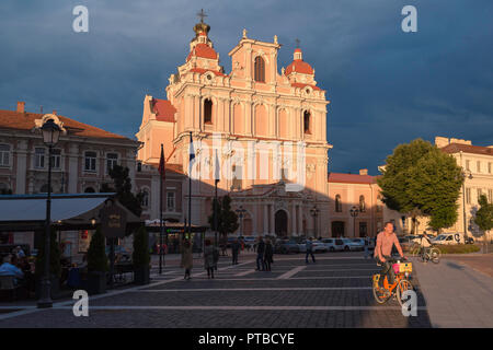 Vilnius Old Town, view at sunset of the Baroque facade of St Casimir's Church in Town Hall Square in Vilnius Old Town, Lithuania. - Stock Photo