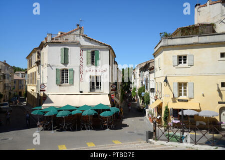 Street Cafes, Sidewalk Cafe, Pavement Cafe & restaurants on Town Square Arles Provence France - Stock Photo
