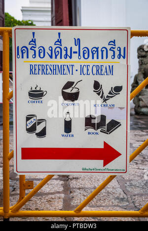 Sign with Thai refreshments and souvenirs as coconut, ice cream, books and drinks - Stock Photo