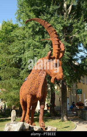 Iron or Metal Sculpture of an Alpine Ibex, Capra ibex, aka Ibex, Steinbock or Bouquetin, in Village Square, Colmars-les-Alpes France - Stock Photo