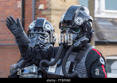 star wars shadow troopers in costumes taking part in a carnival procession on the isle of wight. - Stock Photo
