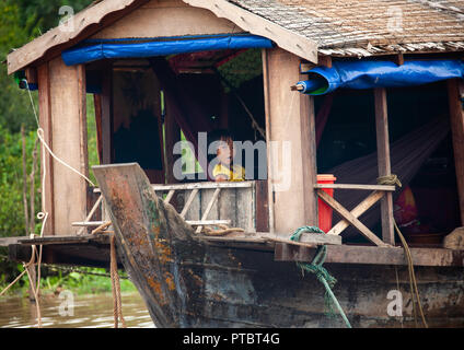 Cambodian girl in her house in the floating village on Tonle sap lake, Siem Reap Province, Chong Kneas, Cambodia - Stock Photo