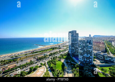 Aerial view of the Mediterranean beaches and modern buildings of Barcelona in the area of Diagonal Mar Catalonia Spain - Stock Photo