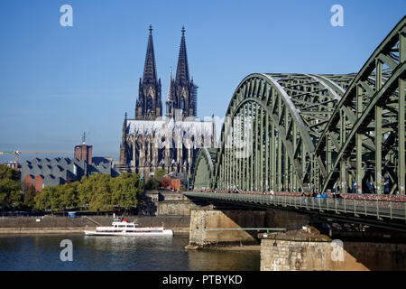 The famous Hohenzollern Bridge over the River Rhine in the centre of Cologne. One of the busiest railway bridges in Germany - Stock Photo