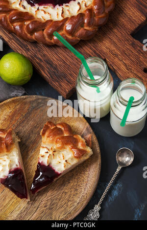 Breakfast pie with cottage cheese and milk on a dark background - Stock Photo