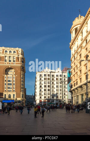MADRID, SPAIN - JANUARY 23, 2018: Sunset view of walking people at Callao Square (Plaza del Callao) in City of Madrid, Spain - Stock Photo