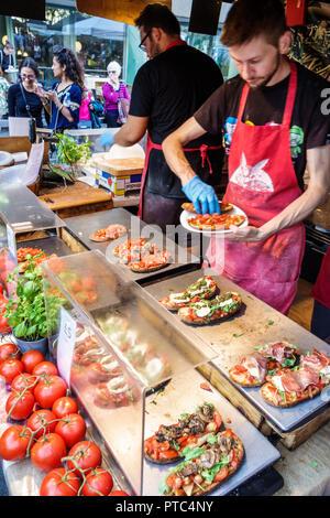 London England United Kingdom Great Britain Lambeth South Bank Southbank Centre center Food Market vendor stall tent kiosk man food preparation handli - Stock Photo