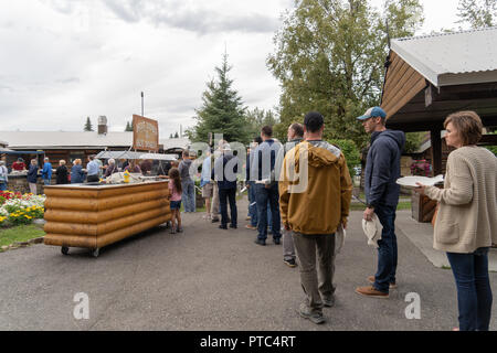 AUGUST 12 2018 - FAIRBANKS ALASKA: Customers line up for the Alaskan Salmon Bake in Pioneer Park, a nightly buffet serving fish and other food during  - Stock Photo