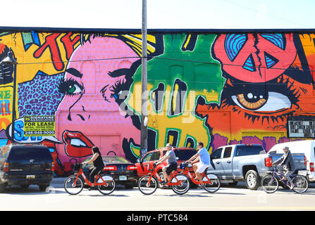Colourful murals at trendy Eastern Market in Detroit, now with hip cafes and warehouses revitalized with artwork, in Michigan, USA - Stock Photo