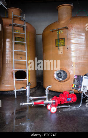 Wine tanks in a wine production facility Apremont Savoy, France. - Stock Photo