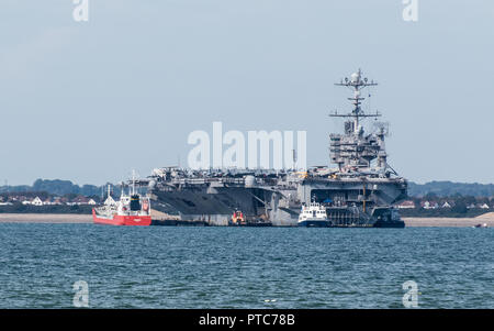 US aircraft carrier, USS Harry S Truman at anchor on a visit to Portsmouth UK - Stock Photo