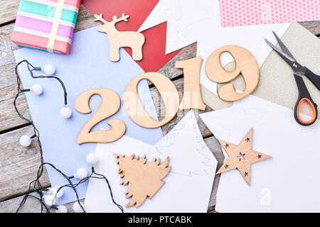Happy New Year 2019 concept. Process of creating New Year wooden decorations, home workshop. Flat lay, tools and materials for creating Christmas orna - Stock Photo