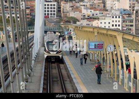 Metro train at Halic station on Golden Horn metro bridge in Istanbul, Turkey - Stock Photo