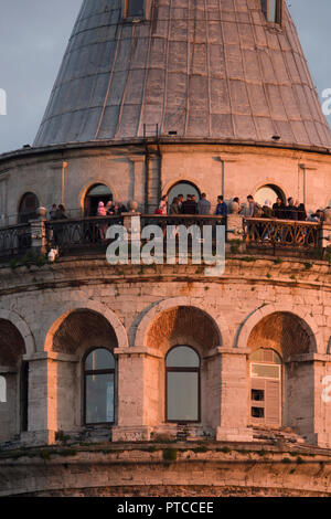 People on the lookout platform of the Galata tower in Istanbul, Turkey - Stock Photo