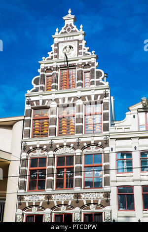Beautiful buildings at the Old Central district in Amsterdam - Stock Photo